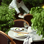 Laid table in street café
