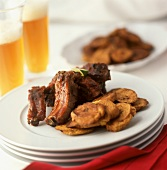 Glazed Barbecued Ribs with Plantain Chips and Beer