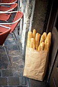 Fresh Baked Baguettes in a Paper Bag Outside a Door
