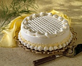 A Yellow and White Frosted Cake