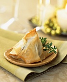A Spinach Stuffed Mushroom Wrapped in Phyllo Dough