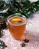 Steaming Cider in Glass Mug with Orange Zest and Star Anise