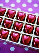 Heart-shaped chocolates, in red foil