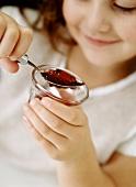 Girl eating jelly