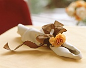 Napkin with rose and bow