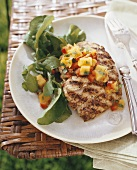 Grilled fish with mango salsa