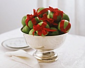 Green apples with red bows