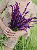 Woman holding a bunch of sage flowers
