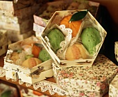 Marzipan fruits in gift boxes in shop