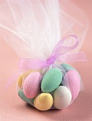 Sugared almonds in pink net