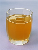 A glass of naturally cloudy apple juice