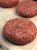 Raw rissoles with freshly ground pepper