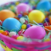 Easter eggs and sugar eggs in coloured basket