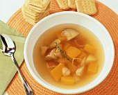 Vegetable broth with turkey, thyme and crackers