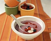 Sweet raspberry & blueberry soup with blob of cream