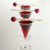 Three glasses of raspberry liqueur