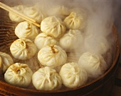Steaming pasta parcels in bamboo steamer