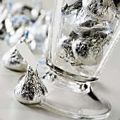 Chocolate Kisses in and Around a Glass