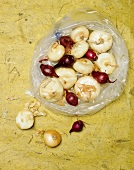 Assorted Onions in and Around a Plastic Bag