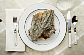 Place setting with piece of tree bark on plate