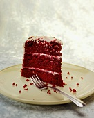 Piece of Red Velvet Cake with soft cheese frosting (USA)