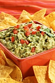 Guacamole in a Red Square Bowl with Tortilla Chips