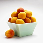 Fresh apricots in square bowl