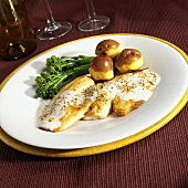 Tilapia fillets with lemon pepper sauce