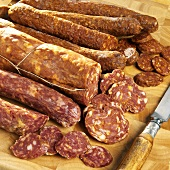 Paprika sausage, sopressata and Calabrese sausages, slices cut