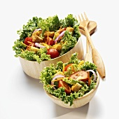 Mixed green salads with vegetables & croutons in wooden bowls
