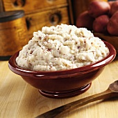 Mashed red potatoes in red bowl