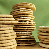 Three piles of crackers against green background
