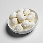 Mozzarella balls in white bowl