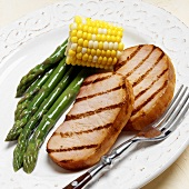 Two grilled smoked pork chops with green asparagus & sweetcorn