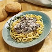 Ribbon pasta with mushroom cream sauce