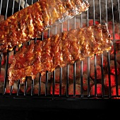 Spare-ribs on smoking charcoal grill