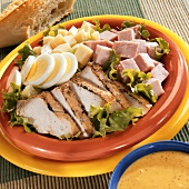 Chef salad with chicken, ham, egg & cheese; mustard dressing