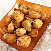 Small Yukon Gold potatoes, fried in butter and oil