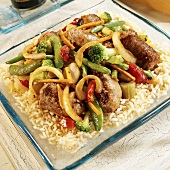 Turkey sausages with vegetables on rice