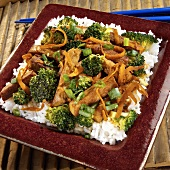 Strips of pork with broccoli on rice
