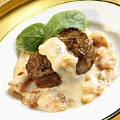 Beef fillet with tomatoes in cheese sauce