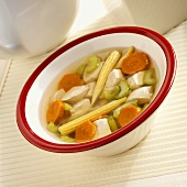Clear broth with chicken, sweetcorn, carrots and celery