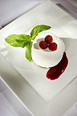 Mascarpone dessert with raspberries and mint