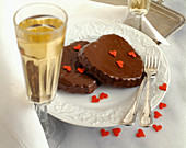 Chocolate hearts and two champagne glasses