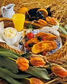 Breakfast tray with French toast, orange juice etc. (USA)