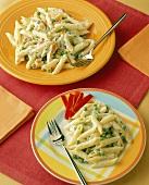 Penne with Alfredo Sauce and Peas and with Smoked Trout