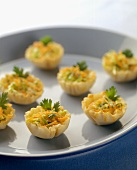 Puff Pastry Hors d'Oeuvres Filled with Cheese and Salad on a Platter