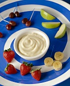 Fruit with Vanilla Yogurt Dip on a Blue and White Swirled Platter