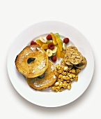 A Toasted Bagel with Fruit and Rice Cakes