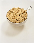 Wheat Cereal in a White Bowl with a Spoon
